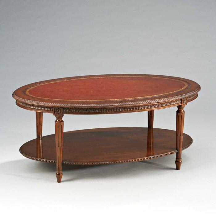 Ovaler couchtisch aus mahagoni mit echtlederauflage tische for Tische couchtische